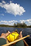 A young man canoeing and camping for 2 weeks in Wabakimi Provincial Park, Stock Photos