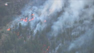 A helicopter makes water drops on a forest fire. Stock Footage