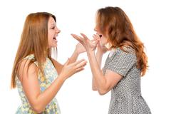 Emotional girl shouting and arguing on a white background isolated Stock Photos