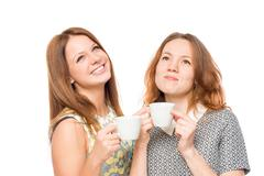 Dreamy girl with a cup of tea on a white background Stock Photos