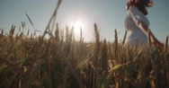 Christianity Concept Young Pretty Woman Raising Hands in wheat field ,sunset Stock Footage