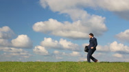 Businessman dancing on the field Stock Footage