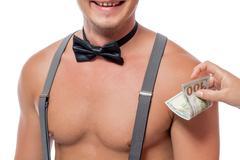 Monetary reward for an erotic dance by women Stock Photos