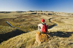 Hiker in the Killdeer Badlands, East Block, Grasslands National Park, Stock Photos