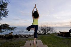 A woman practices yoga on a beach near Gibsons, British Columbia, Vancouver Stock Photos
