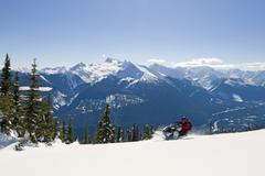 Fast action and a stunning day make for a perfect mix for a snowmobiler in the Stock Photos