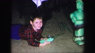 1972: child plays with toy robot LYNBROOK, NEW YORK Stock Footage