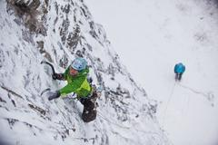 A strong female ice climber works her way up Snowline WI4, Even Thomas Creek, Stock Photos