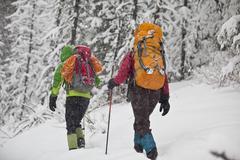 Two female ice climbers heading to climb Moonlight WI4, Even Thomas Creek, Stock Photos