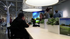 People eating foods and chatting inside Ikea restaurant Stock Footage
