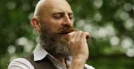 4k, A hipster businessman smoking an electronic pipe while on his smoking break. Stock Footage