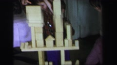 1972: children playing and stacking various wooden blocks on the floor LYNBROOK, Stock Footage