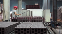 Worker working on the assembly line in a brick factory Stock Footage