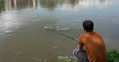 Sergiev Posad, Cellarer of the pond, a young man catches a fish Stock Footage