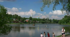Sergiev Posad, an ancient County town, the children at the pond Stock Footage