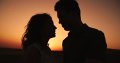 Sun in hands.Happy Couple making shape of Heart beautiful sunset on horizon Stock Footage