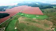 Aerial view of golf fields Stock Footage