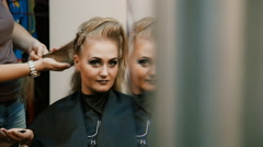 Hairdresser makes hairstyle girl Stock Footage