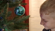 Cute little boy playing with christmas ball Stock Footage