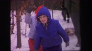 1972: two boys play in the snow together with a sled LYNBROOK, NEW YORK Stock Footage