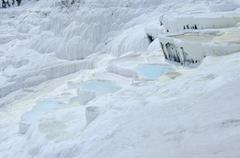 Pamukkale hot springs and travertines, terraces of carbonate minerals left by Stock Photos