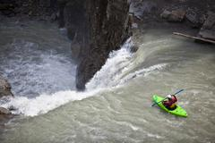 A male kayaker drops a large waterfall on the Bighorn River, Nordegg, Alberta, Stock Photos
