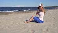 Young woman talking by cell phone on the beach Stock Footage