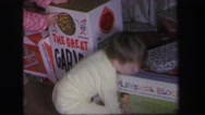 1972: excited children at christmas time getting their presents to open them. Stock Footage