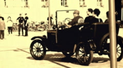 Driving a city street with a Ford model T 1921 Stock Footage