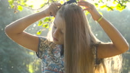 Pretty girl combing her hair Stock Footage