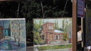 Exhibition of paintings in the street Stock Footage