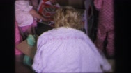1972: a family with small children opening presents in their pajamas on Stock Footage