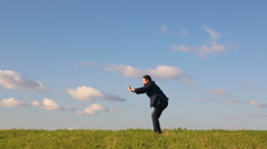 Businessman pushing invisible barrier Stock Footage