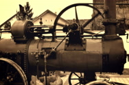 Steam engine driven threshing machines Stock Footage