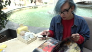 Transgender Gay with blue Hair takes photo Phone Fashion Magazine at the Mall Stock Footage