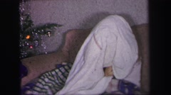 1972: christmas time with brothers one wearing army helmet  Stock Footage