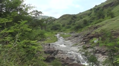 Big River Flows in Long Way Over Rocks Between Mountain Green Forest Scenery. Stock Footage