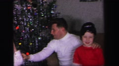 1972: childrens are celebrating a festival with his father or relatives Stock Footage