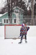 Boy playing ice hockey, on an outdoor neighborhood rink, Winnipeg, Manitoba, Stock Photos