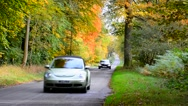 Cars on a country lane in the woods Stock Footage