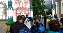 Visitors to the monastery at the well with Holy water Stock Footage
