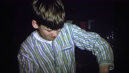 1974: the boy doing something with board in a crazy way LYNBROOK, NEW YORK Stock Footage