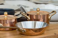 New copper cookware - pots and pans Stock Photos