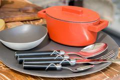New modern cast iron cauldron and kitchen appliances Stock Photos