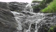 Waterfall from Hills Water Flows Over Big Rocks Nature Scenery Stock Footage