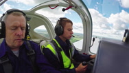 Flight Instructor Teaching Student in Air Stock Footage