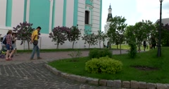 The base five-tiered bell tower, blooming lilacs, the territory of the monastery Stock Footage