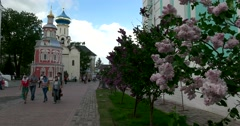 Assumption Chapel over the well, the blooming lilacs,  territory of  monastery Stock Footage