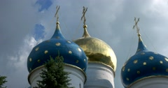 Golden crosses on the cupolas of the majestic white-stone assumption Cathedral Stock Footage