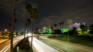 4K time lapse of Los Angeles city overpass traffic at night on the 110 freeway Stock Footage